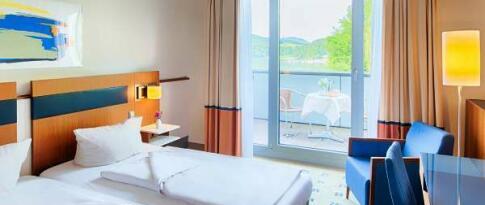 Deluxe kamer met uitzicht en balkon
